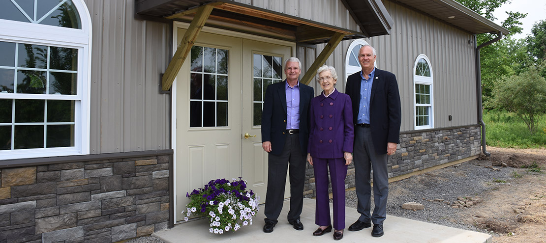 Harried Moyer with Kent Yoder, board chair, and Jim Harder, Bluffton president