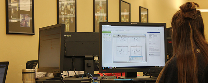 Students work use technology center