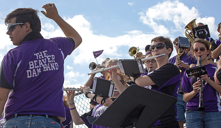 Bluffton University senior directs the pep band at a home football game