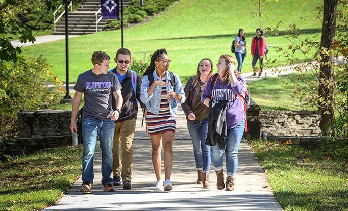 Students enjoy a fall walk across campus