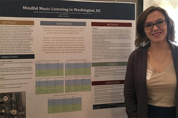 Anna Cammarn '18, double major in psychology and music, presenting her research at an undergraduate research conference.