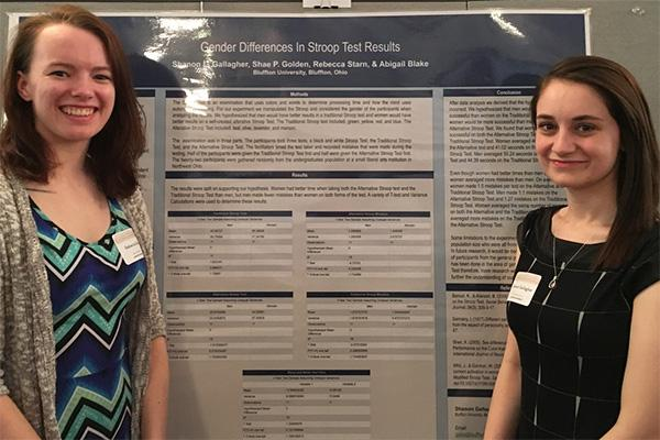 Becca Starn and Shanon Gallagher, 2018 graduates, presenting their research at an undergraduate research conference.