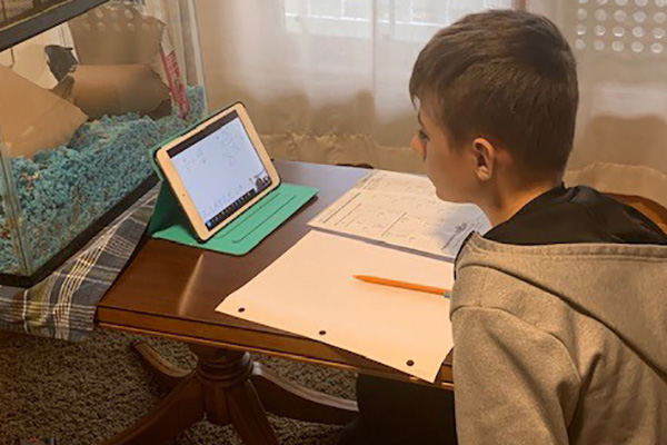 Keane Arron gets help with homework from his Bluffton Study Buddy.