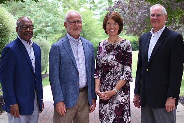 Retiring trustee Lawrence E. Milan '73, retiring vice president for advancement Dr. Hans Houshower, President Dr. Jane Woods and retiring trustee James T. Sommer '68.