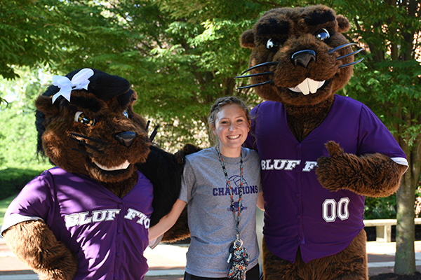 Caitlyn Renner with Bluffton's mascots, J. Denny and Jenny Beaver
